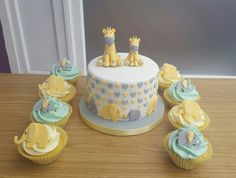 Giraffe and elephants baby shower cake and cupcakes
