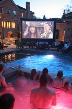 Implementing Creative Ideas at Your Community! Watching a movie poolside!