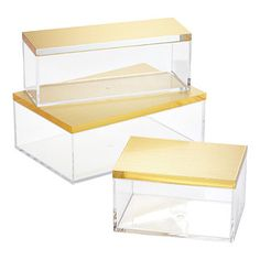 Our Clear Boxes with Metallic Lids are the statement pieces you've been waiting for. Their mod yet sophisticated design looks perfect no matter where its displayed, making it ideal for holding a wide variety of treats and accessories.