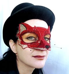 Red fox masquerade mask, handmade. $500.00, via Etsy.  Wait, - rethink... I'm fearful we're going to go too far with our  fox thing and end up on the dark side!