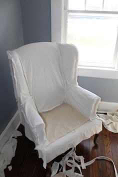 Learn how to slipcover a wingback chair with painter's drop cloth. I have included a video documenting the whole slipcovering process, lots of instructions and my tips for an excellent fit. Wingback Chair Slipcovers, Patio Chair Cushions, Furniture Slipcovers, Chair Upholstery, Upholstered Chairs, Drop Cloth Slipcover, Custom Slipcovers, Swivel Chair, Diy Furniture Chair
