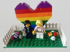 This is a *Customised* Lego Gay Wedding Cake Topper featuring a Choice of 2 slightly different Gay Pride Rainbow Hearts with Bride And Bride Minifigures, Flowers and CHOOSE either a Gold Coloured Ring or a pair of Goblets/Glasses  MADE TO ORDER - I CAN CHANGE THE BRIDES OUTFITS, HAIR COLOUR/STYLE, HEADS - PLEASE MESSAGE ME WITH YOUR REQUIREMENTS Includes the baseplate - white, green, tan, blue or pink  You will receive 2 groups of flowers - you choose the colours  Unusual super cut...