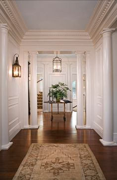 Family Home with Classic Coastal Interiors Beautiful traditional foyer. Sconces are from Charleston Lighting Classic Interior, Home Interior Design, Gray Interior, Luxury Interior, Modern Interior, Casas Na Georgia, Style At Home, Interior Columns, Style Deco