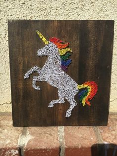 Always be yourself, unless you can be a UNICORN.. then always be a unicorn! This listing is for one string art sign measuring approx. 10 X 15 inches. The board is stained in an early American stain, but can be changed upon request. Unicorn and hair color can be changed. Please specify in notes to seller section. Unicorn can be excluded to create a HORSE sign.  By default, each sign comes with a wire on top to hang. A ribbon is added in a coordinating color. Wire can be excluded at no…