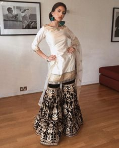 Image may contain: 1 person, standing, shoes and indoor Indian Gowns, Indian Attire, Indian Outfits, Indian Wear, Indian Party Wear, Indian Lehenga, Gharara Designs, Capsule Wardrobe, Forever21