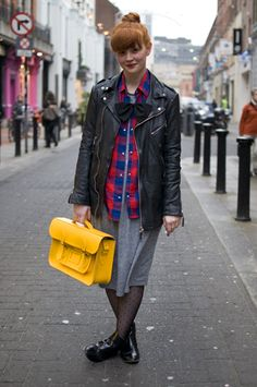 Wendy, bow boutique owner: (Dublin)  What: Wendy's tough meets feminine look is polished off with a bright yellow satchel and the cutest bow tie.    She: Wendy, bow boutique owner    Wears:     Jacket: Whistles    Shirt: Zara    Bow: Designer – Emma.j.Doyle    Dress: Topshop    Bag: Cambridge Satchel    Shoes: Kurt Geiger