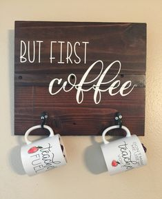 """But first coffee"" wood sign and coffee mug hanger. Includes two hooks to hang a mug. Measures Hand painted, no vinyl stickers, and varnished so it's made to last. Customization of size and colors available, just shoot us a message."