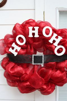 "HO HO HO Santa Wreath.  Pinner writes:  ""Very adorable!  Made from metallic red deco mesh on a 24"" wreath form.  Santa's belt buckle is made from wood that is painted black with silver glitter and is attached to black and silver deco mesh.  HO HO HO letters are painted white all over with white glitter. The wreath measures 35"" across, tip to tip."""