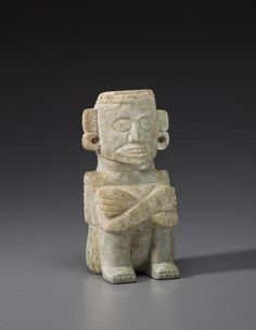 Mixtec Penate in the form of Noble Ancestor, ca. A.D. 1300-1521 Greenstone height 6 (15.25cm)  Small figurines of this kind were carved in green stone from various sources and range from jade-like green to beige in color. The size and shape of this example indicates that it represents a seated ancestor and was probably kept in a sacred bundle to be venerated on a palace altar.