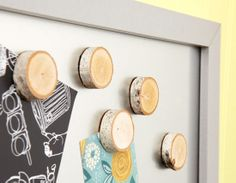 Glue magnets to the back of small branch slices. For 11 more tree branch makeover ideas, click the image.