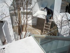 """""""House before House"""" is the most complex of the SUMIKA structures, a labyrinth of steel boxes in a snakes-and-ladders-like arrangement of steel structural stairs and removable wooden ladders. Architect: Sou FUJIMOTO"""