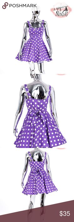 purple polka dot dress purple lavender polka dot dress. worn once for a photoshoot then decided purple really isn't my color (i have pink hair) tie back, stretchy made in USA, medium but can fit a small (petticoat not included) lightly padded bust Xia Dresses Midi