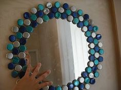 Bottle Cap Mirror.... Now I know what to do with all the beer caps my husband leaves around!!!!