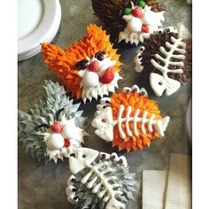 Fat Cat Cupcakes ~ These happy cats have dined on white chocolate fish bones. Candy mints form their smooth white cheeks, and soft marshmallow paws hold their frosted tummies.
