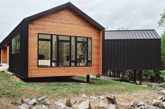 """The metal cladding, inspired by a nearby zinc mine, continues seamlessly onto the house's roof for a minimalist shed effect. """"The drip edge turns to make the wall,"""" explains architect Brandon Pace, """"but changes above the window to accommodate a downspout. Roof Cladding, Cedar Cladding, House Cladding, Facade House, Roof Design, House Design, Building A Container Home, Cedar Homes, Roof Architecture"""