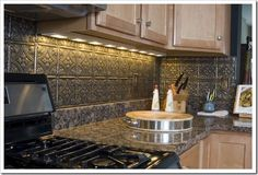 Much too busy between the textured backsplash and the granite countertop