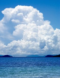 White puffy clouds, blue water and sky.    This is just amazing.. in every way possible