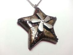 Steampunk star Necklace with spinning action by xDonnaxthexDeadx, $30.00