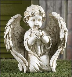 NEW! Sitting Angel holding dove now available for only $26.00.