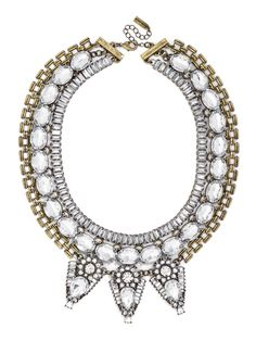 A formidable triple-layered necklace features strands of clear crystals along with intricate gem stations and antique metal for a vintage-inspired, multi-strand statement.