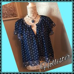 Lovely Sheer High/Lo Blouse This light and airy Hollister Top is a Re-Posh. I hate to part with it but it is too small on me. Longer in back, shorter in front, beautiful navy blue with turquoise and white accents. Perfect condition. Hollister Tops Blouses