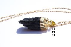 Raw black tourmaline pendant dipped in gold laced on a necklace. All pendants are genuine so stones may vary. Black tourmaline is used for spiritual grounding, this stone is good for cleansing and balancing. Cute Jewelry, Jewelry Accessories, Volleyball Tryouts, Diy Bead Embroidery, Tourmaline Necklace, Nikko, Gold Plated Necklace, Black Tourmaline, Polymer Clay Jewelry