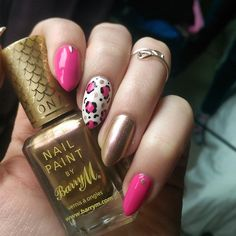 Bright pink for this rainy day ☔ love it with this gold! Barry M 'Caspian' Models Own 'Cerise Shine' and Barry M Nail Art Pens 💅🎨😊 #notd #nailsofinstagram #nailstoinspire #nailporn #nailpolishobsession #nailart #nailartoohlala #toomanypolishes #leopardprintnails #pinkandgold #animalprintnails #pinknails #pinknailart