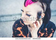 young beautiful punk dark girl listening music in urban landscape - stock photo BUY IT FROM $1