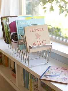 Using a magazine rack to organize the books you display