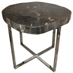 Indonesian prehistoric petrified wood top side table on brushed nickel base. www.balsamoantiques.com