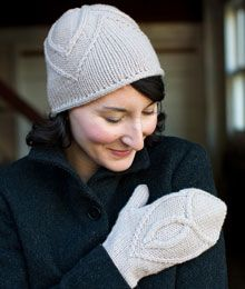 Both the hat and mittens are worked in the round from the top down on double pointed needles. Shaping is integrated into the cable patterns, which are presented in both charts and row-by-row instructions. Both the hat and the mittens are finished with an i-cord bind off.