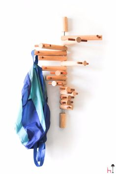 this coat rack has swivel arms that will hold any kind of items