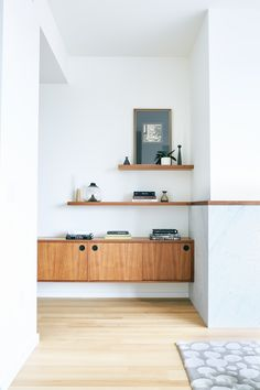 Custom walnut built-ins give purpose to an extra wide hall