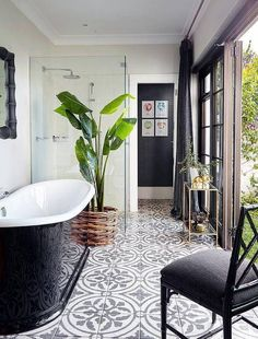 Love these tiles! Black and white bathroom features a glossy black freestanding tub atop a black and white concrete tile floor which continues into the seamless glass glass shower which is placed next to the tub. Bathroom Floor Tiles, Bathroom Renos, Bathroom Interior, Small Bathroom, Bathroom Ideas, Tiled Bathrooms, Kitchen Floor, Bathroom Black, Master Bathroom