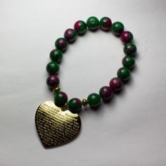 Women Bracelet 10mm Ruby in Zoisite with Gold Heart Charm