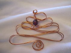 Use coupon code: PIN10 for 10% off! What a great addition to your Christmas tree ornaments, this wire tree (shown in copper with a purple faceted bead charm.)   If you need larger quantities please inbox me v... #homemade #ornament