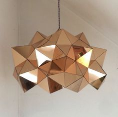 Gold Mirror Half Geometric Sculptural Pendant Light by BrittaGould on Etsy https://www.etsy.com/listing/240729657/gold-mirror-half-geometric-sculptural