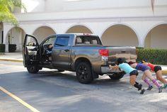 CrossFit girls can...push trucks?