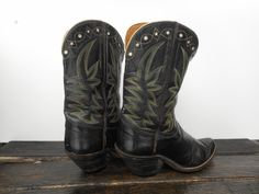 Beautiful ladies Hyer boots. Black, supple leather with green and cream flame stitching. Stars and moons detailed at the top of shafts. Circa 1940. At Cayuse in Jackson, Wyoming.
