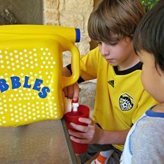 Make your own bubble dispenser from an empty laundry detergent bottle!