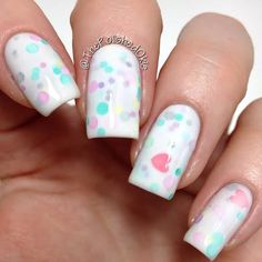A white crellie with matte pastel dots, hexes and matte pink hearts. Use the drop down menu for your choice of mini or full size.