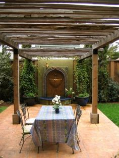 mediterranean exterior by Kathleen Shaeffer Design, Exterior Spaces Like that the trellis is attached to same wall as the fountain