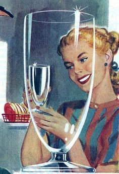 1947 vintage Happy Housewife practicing her smile in the reflection of her clean glass.