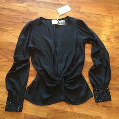 Black sheer top NWOT Cuff accents black shirt. NWOT. Wear with a dark bra or tank top Bloomingdales Tops Blouses