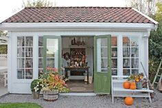Countryside Charm - The Most Charming Garden Sheds on Pinterest - Southernliving. French doors open into this elegant but simple shed. A crisp white exterior is the perfect balance to the rustic red shingles. See the Pin