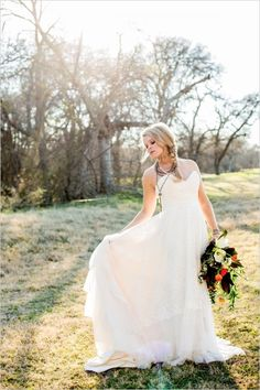 Strapless wedding dress from De Ma Fille. #weddingchicks Captured By: Lightbox Photography http://www.weddingchicks.com/2014/06/20/funky-braided-wedding/