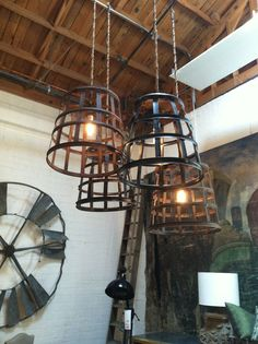 Wrought iron chandeliers crafted in LA by the welders and craftsmen @Cisco Home. #sustainable #recycled living
