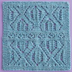 Knitterati Afghan Block 28 by Lynette Meek using Cascade Yarns® 220 Superwash®. A textured lace square is worked in two mirrored halves with a center band to create a visually arresting design.