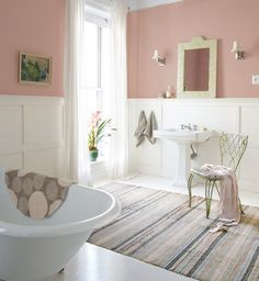 Charming bathroom. Love the wainscot // pink walls