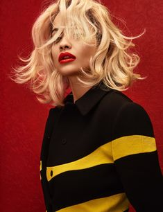 Rita Ora retro chic with a wavy hairstyle and glossy red lips channeling Marilyn Monroe for Wonderland Magazine Photoshoot